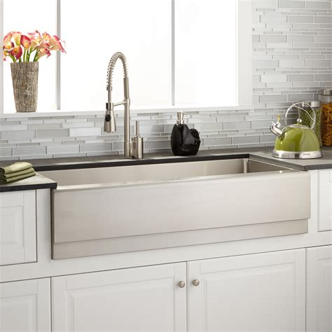 dual farmhouse sink with gooseneck faucet transitional