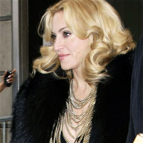 madonna in a fur coat peta has named madonna the worst dressed
