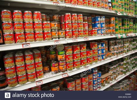 What Is The Shelf Of Canned Soup by Canned Goods On Shelf In Supermarket In Oaxaca Mexico
