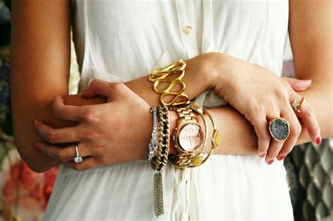 a model s secrets bracelet style arm layering