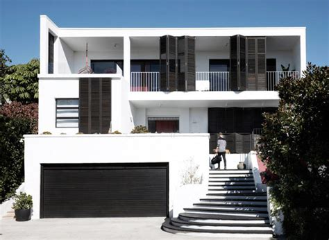 black and white house with two amazing terraces digsdigs