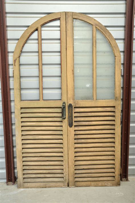 Louvered Glass Doors Arched Doors With Glass And Louvered Panels At 1stdibs