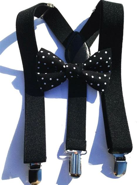 black suspenders and black bow tie with small white polka