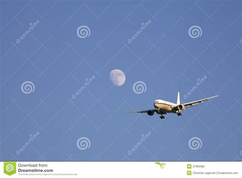 coming in for a landing ten years flying in the islands books airplane flying past the moon royalty free stock photo
