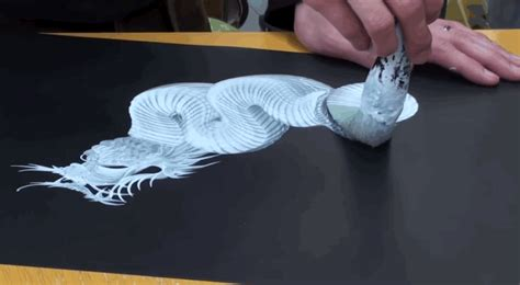 watch japanese artists paint dragons with a single