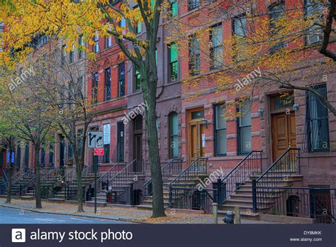 how to buy a house in nyc harlem row houses in autumn new york city new york usa stock photo royalty free