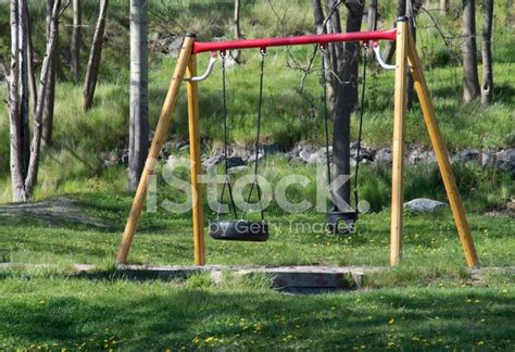 pas grass swinging swings on green grass stock photos freeimages com