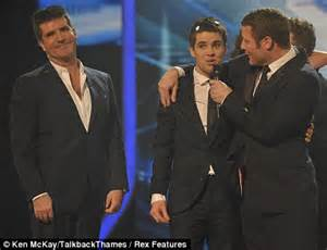 donald trump x factor and the winner is simon cowell after the most watched