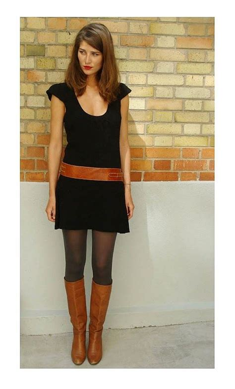 black dress black tights brown boots brown belt minis