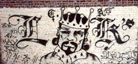 identify gang graffiti p ink  paint