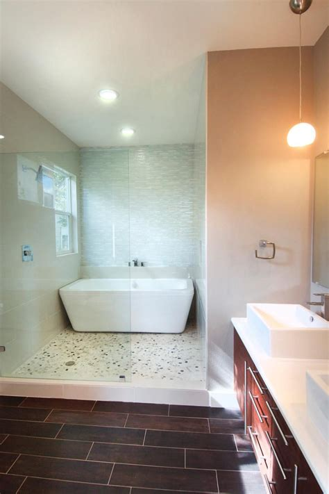 bathtub in room this contemporary bathroom features a spa like room with a glass enclosure wood look tile