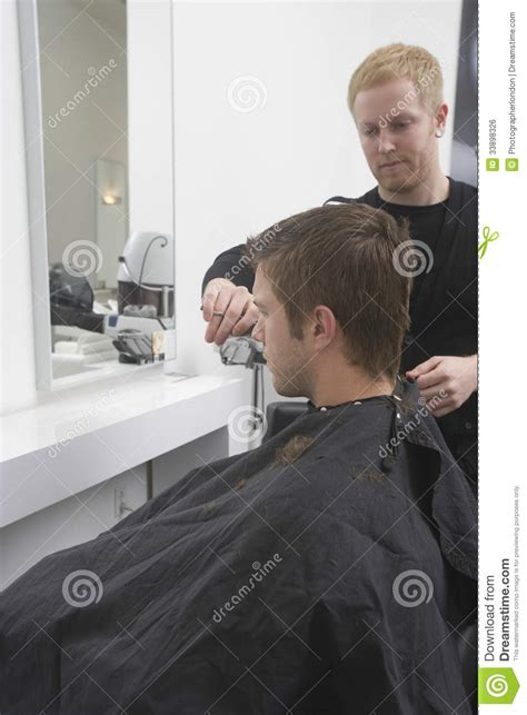 beauty salon boys man getting an haircut from hairdresser stock photo