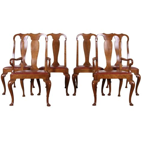 set of six walnut style dining chairs by baker