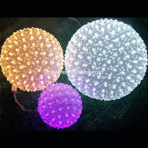 yellow christmas ornament balls outdoor hanging light