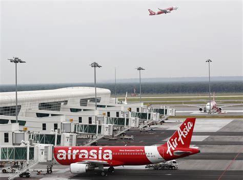airasia kuala lumpur airasia blasts malaysia airport operator for sinking new