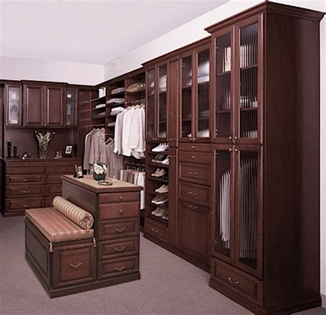 walk in custom closet island with bench