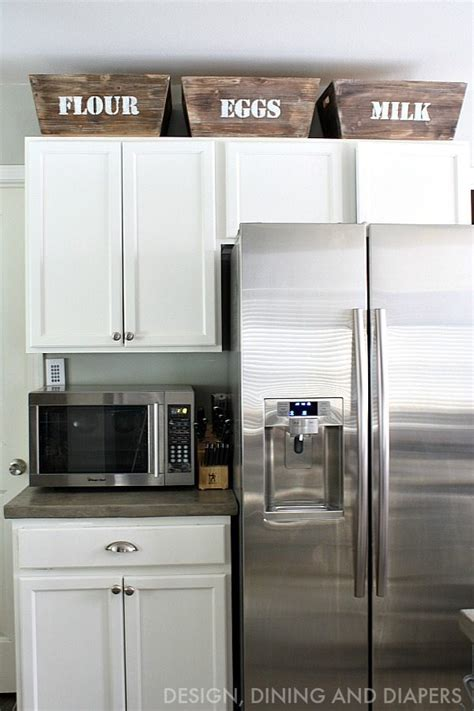 small cabinets above kitchen cabinets small kitchen remodel with a modern farmhouse style