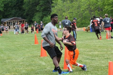 School Arm 5325 by Adapted Football League Players Learn From The Pros