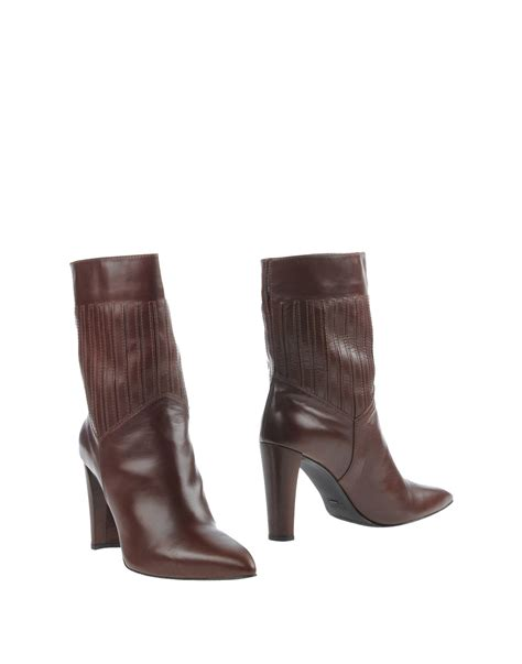 stuart weitzman ankle boots lyst stuart weitzman ankle boots in brown