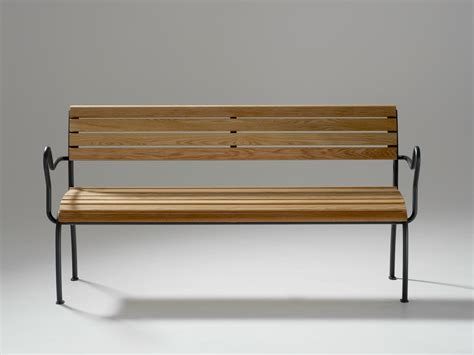 a bench wooden bench with armrests access by nola industrier