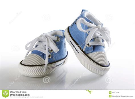 blue baby shoes blue baby shoes with reflection royalty free stock images