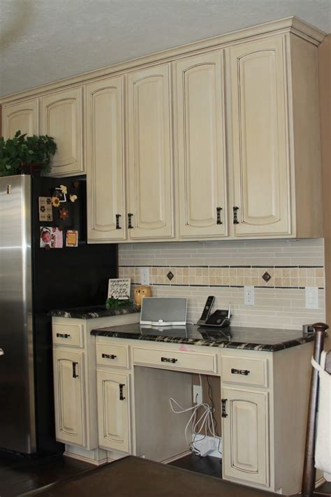 white cabinets with brown granite off white kitchen cabinets with antique brown granite