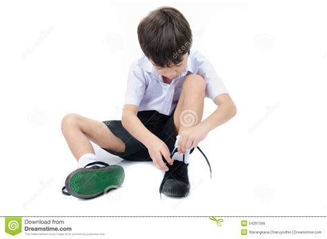 kid tying shoes boy tie shoes ready for school on white background