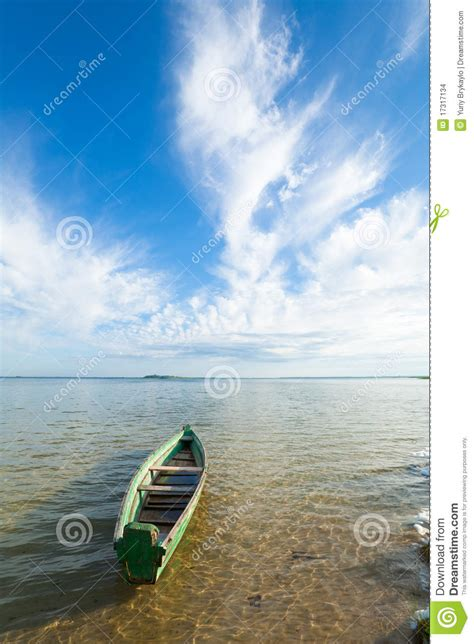 summer bank boat on summer lake bank stock images image 17317134