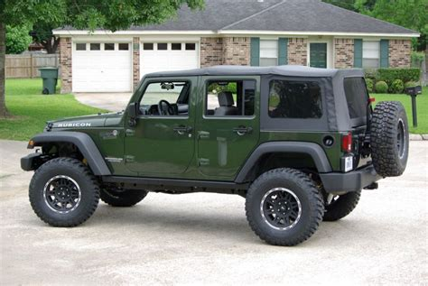 dark green jeep lifted post your jeep green metallic with black wheels jk forum