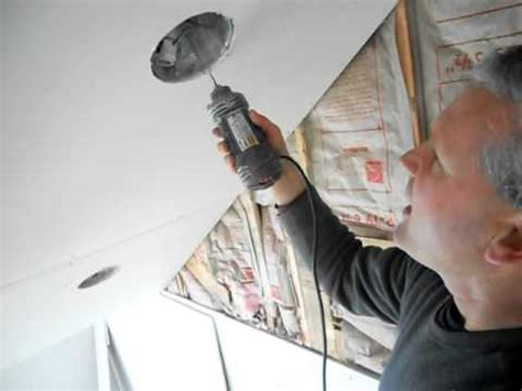 Cutting In A Ceiling by Cutting Drywall With Rotozip For Recessed Ceiling