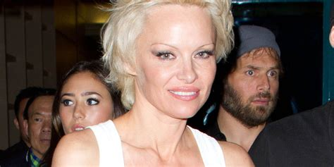 pamela anderson tattoo removal finally starts to remove barbed wire