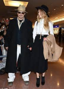 Amber Heard is the picture of happiness on Johnny Depp's