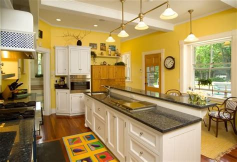 what color cabinets go with yellow walls pictures of