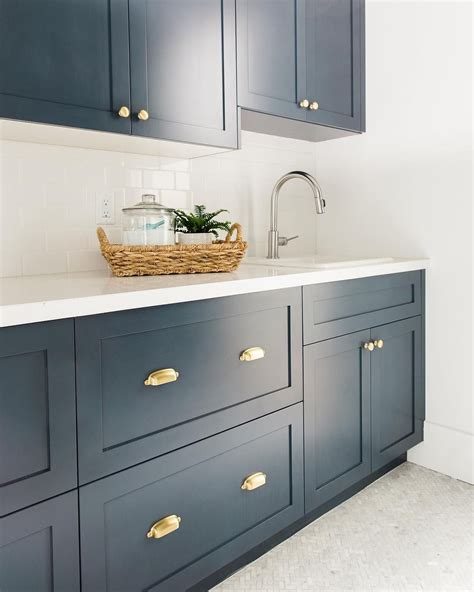 navy blue cabinet pulls bm hale navy pure white caesarstone countertops brass