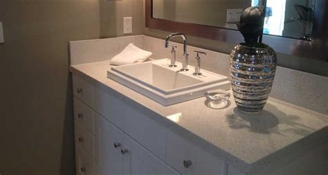 Natural Stone Kitchen Backsplash bathroom room scene iced white quartz countertop