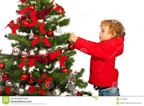 tree with a toddler toddler boy decorate tree stock photo image
