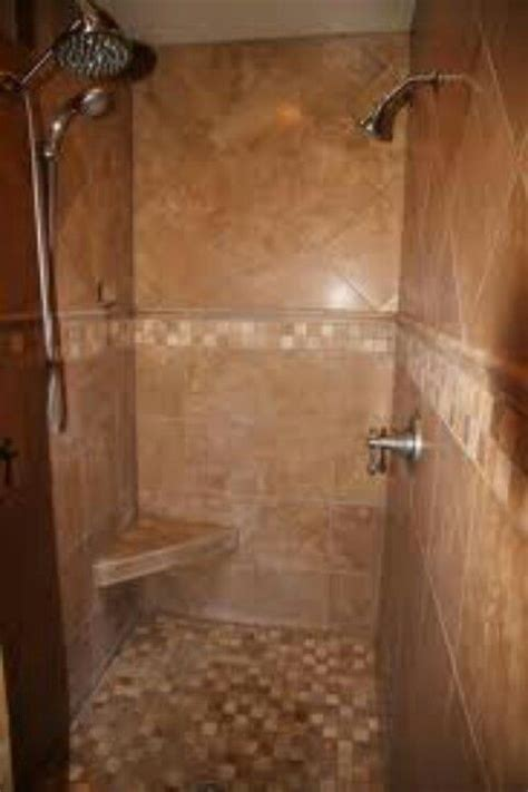 built in shower two shower heads and a built in seat built in showers