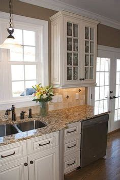 metro cabinets granite creations baltic brown granite countertops light maple floors add