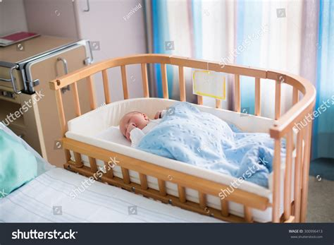 bedside baby bed newborn baby hospital room new born stock photo 300996413