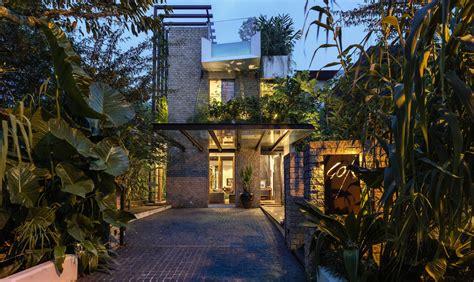 lush gardens  peekaboo roof pool define contemporary home