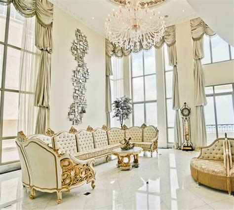 living room with large chandelier high ceiling