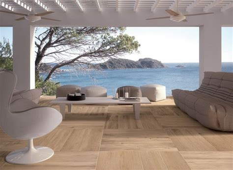 light outdoor space in white with wooden floor tiles and