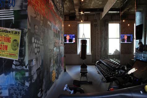 wheatpaste street artist paints corporate gym mural