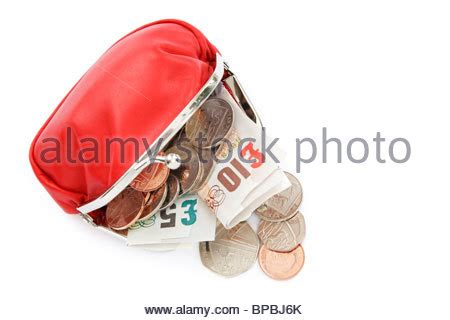 Five Pound Coin Purses From Topshop by Uk Currency Notes And Coins On A Table Stock Photo