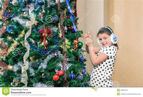 little pretty happy girl decorating and preparing a