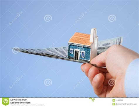 new house what to buy businessman offering to buy a new house stock photo image 61320054