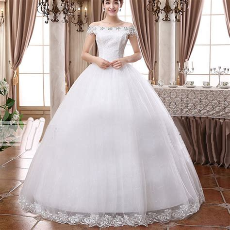 White Bridal Gowns by White Bridal Slash Neck Solid Lace Floor Length Gown