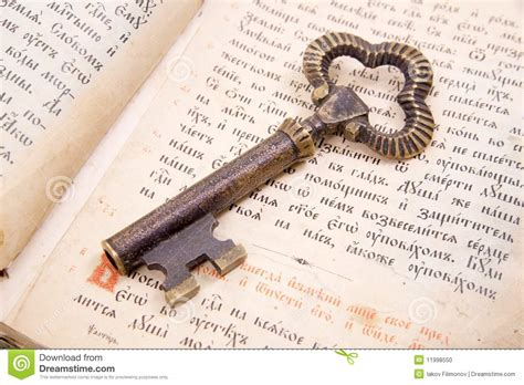 libro photography the key concepts closeup of key placed on vintage book bible stock photo image 11998550