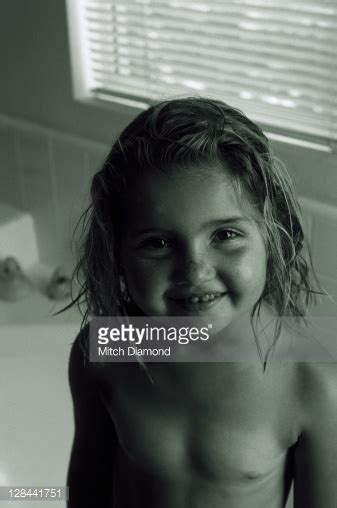 naked girls in a bathroom young girl semi nude in bathroom stock photo getty images