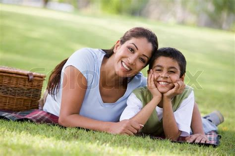single moms with feminine sons mother and son having picnic in park stock photo colourbox
